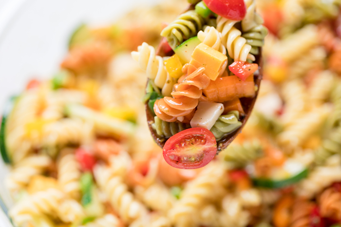 close up of vegan pasta salad on a spoon