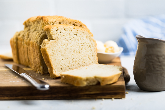 horizontal image of loaf of yeast free vegan bread sliced