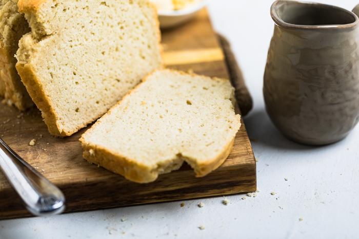 slice of yeast free vegan bread on a cutting board