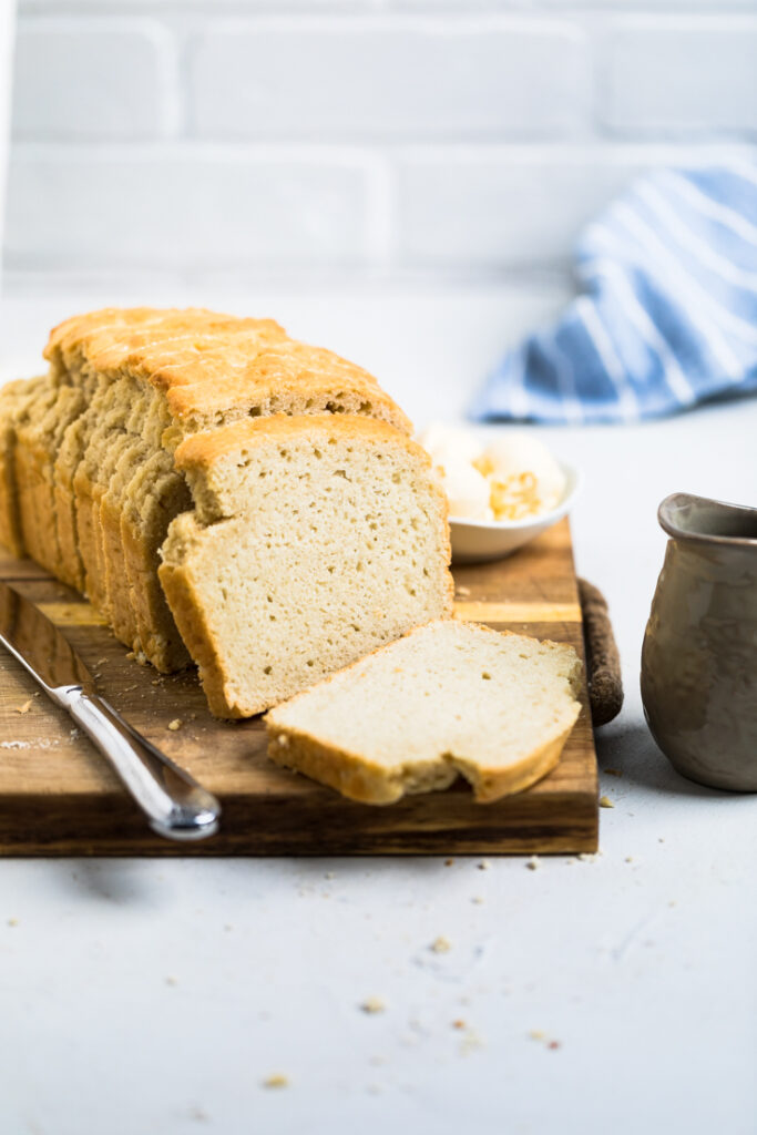 loaf of yeast free vegan bread sliced taken further back