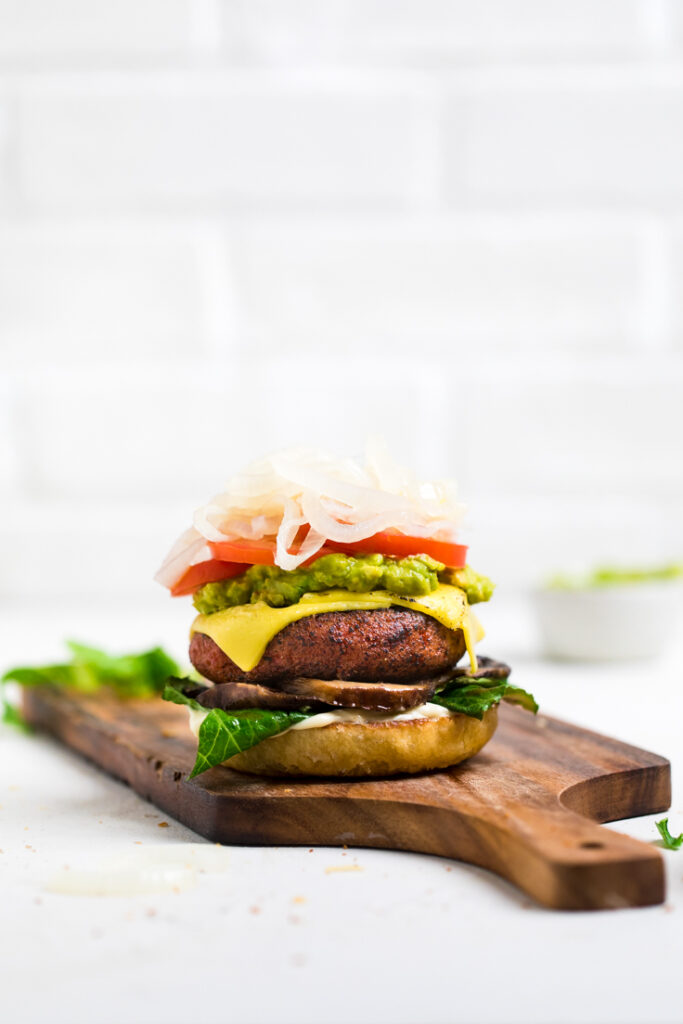 high protein vegan burger on a cutting board without a top bun