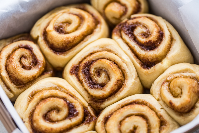 9 no yeast vegan cinnamon rolls in a pan without frosting