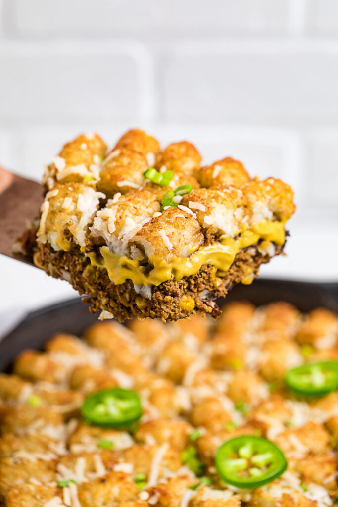 close up of tex mex vegan tater tot casserole cut out of skillet
